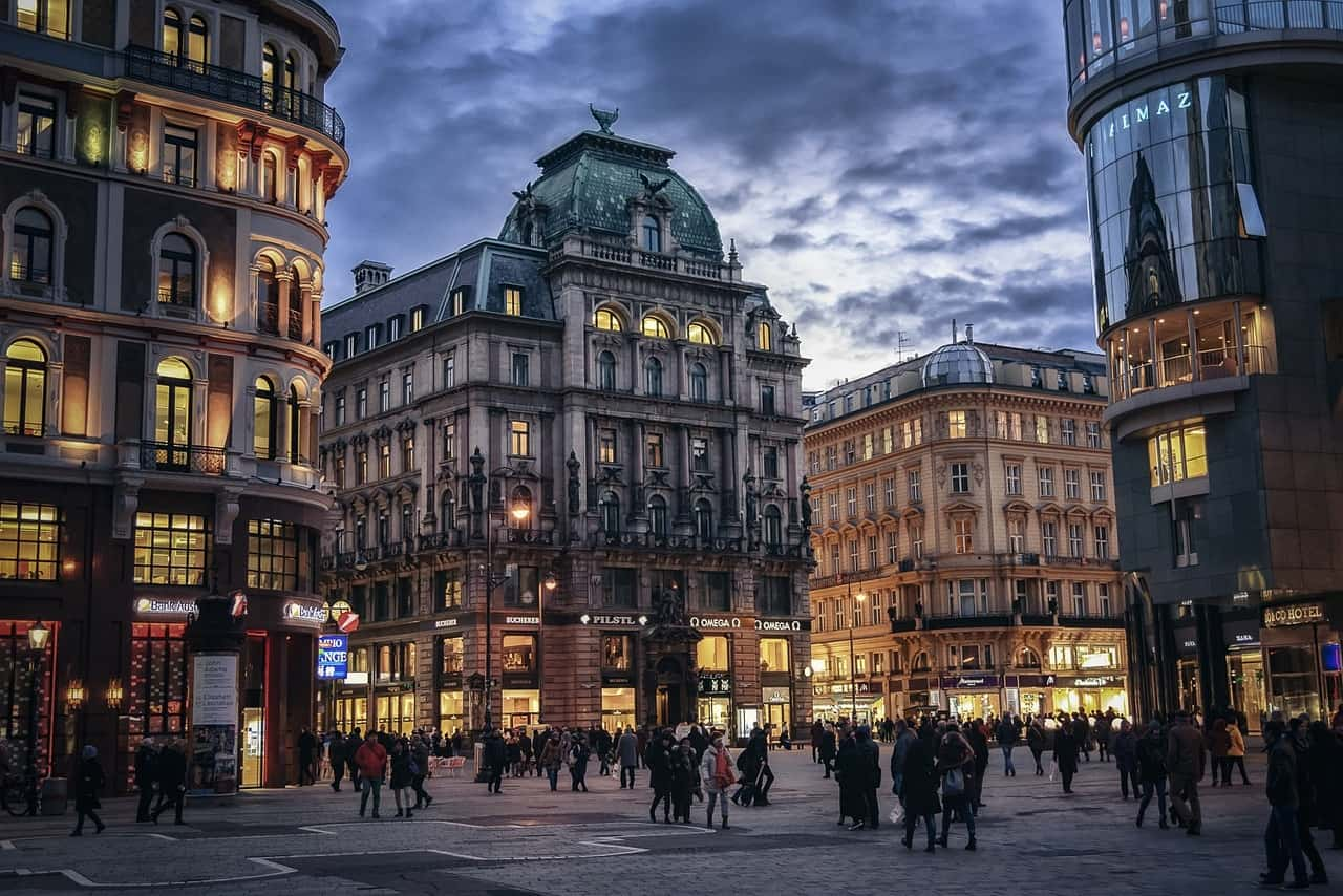 Vienna city centre at night time, lots of people walking around