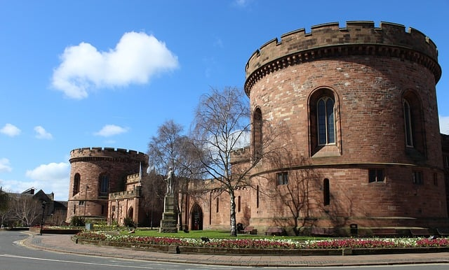 Two turreted towers of Carlisle castle with a statue in between on a winters day